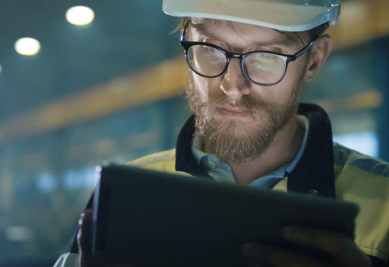 Engineer looking at computer
